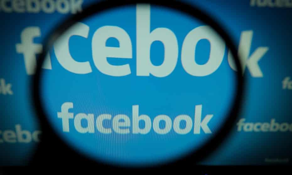 Facebook logos are seen on a computer screen