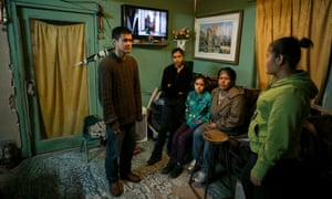 The Cardenas family are photographed in their home