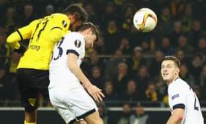 Borussia Dortmund's Pierre-Emerick Aubameyang gets above Ben Davies to score the first goal of the match.