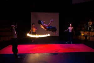 Artists do flips over a burning jump rope during a performance of Eclipse