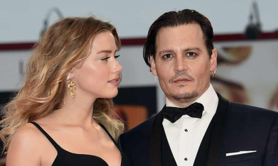 Johnny Depp with Amber Herd, pondering how he's going to parry the latest salvo from Barnaby Joyce.