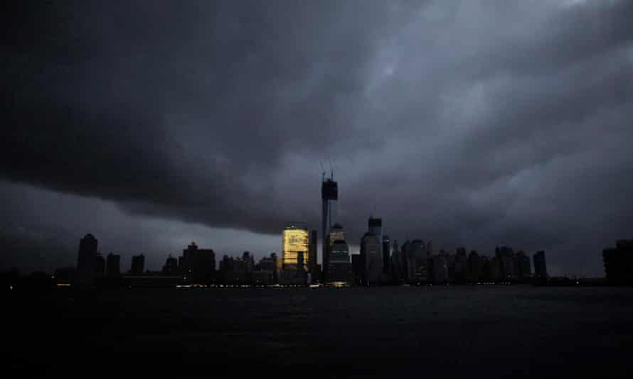 The skyline of lower Manhattan is mostly in darkness except for the Goldman Sachs building after a preventive power outage caused by giant storm Sandy, in New York on 30 October 2012.