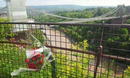 Flowers left in memory of Olive Cooke by the Clifton suspension bridge.
