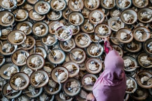 A woman prepares meals for Muslims breaking their fast during the holy month of Ramadan at Jogokariyan Mosque in Yogyakarta, Indonesia
