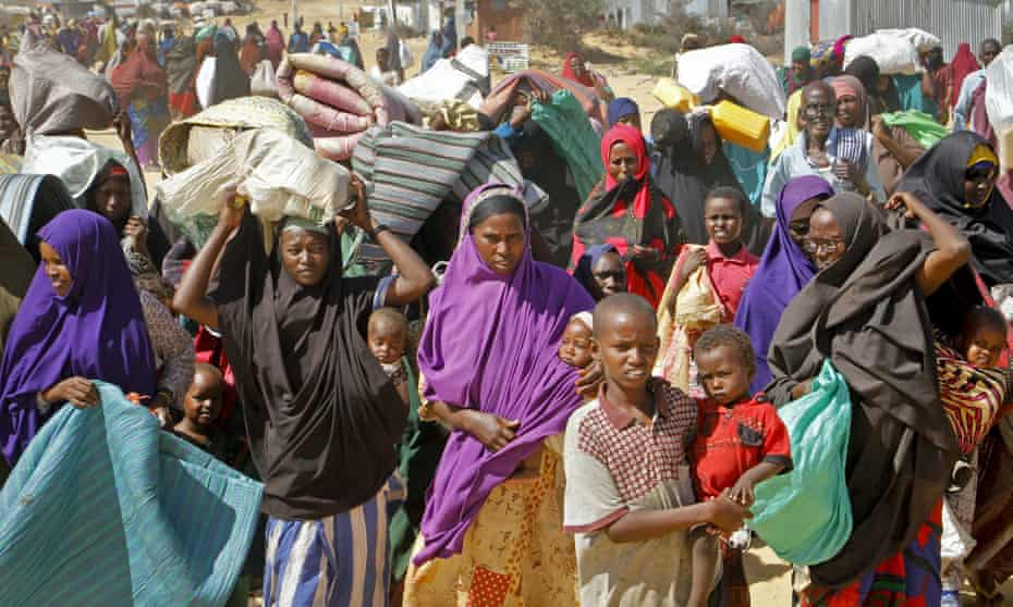 People fleeing drought in the Lower and Middle Shabelle regions of Somalia reach a makeshift camp for displaced people on the outskirts of Mogadishu