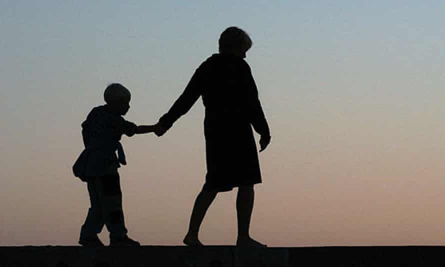 Silhouette of a mother and a child in the evening