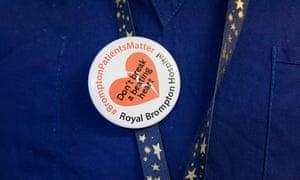 A nurse wears a campaign badge at Royal Brompton hospital.