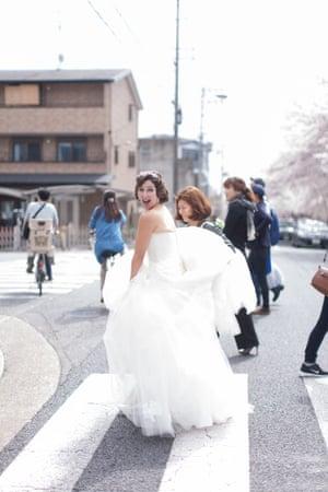 Naomi Harris on a zebra crossing in Japan in a wedding dress