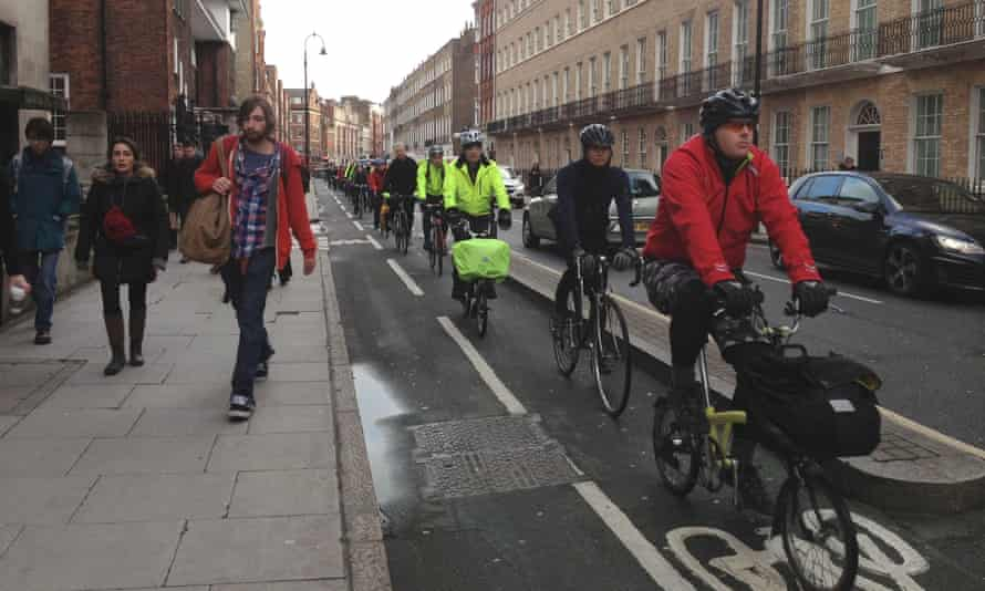 Commuters cycling in London