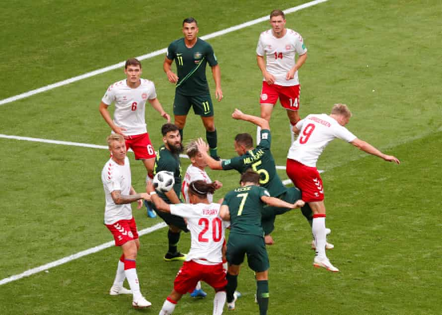 Mathew Leckie heads the ball on to the hand of Denmark's Yussuf Poulsen for the latest penalty awarded with the aid of technology