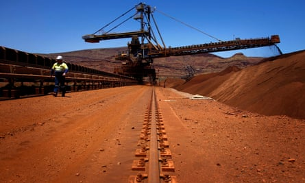 File photo of conveyor belts transporting iron ore at a Fortescue mine south in the Pilbara