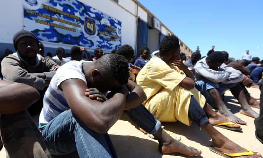 Migrants gather at the Tajoura detention centre in Tripoli.