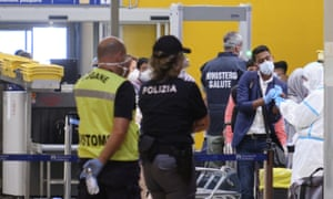 Italian health personnel check passengers arriving on a flight from Bangladesh at Rome's Fiumicino airport