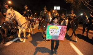 Police on horseback and on foot clear the anti-Trump demonstrators.