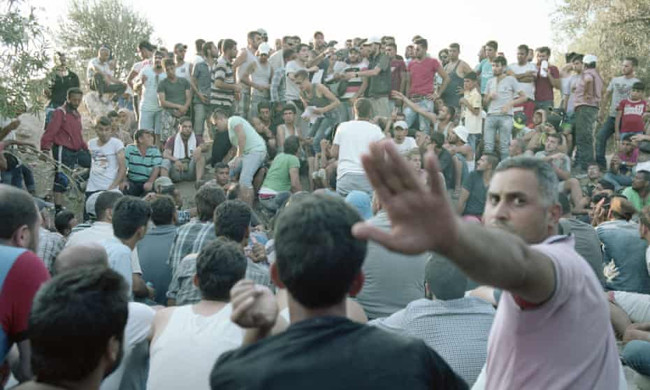 Kara Tepe refugee camp on Lesbos in Greece. The men, mostly Syrians, are waiting for registration papers, July 2015