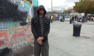 A man stands by the men's side of the Road Home shelter in Salt Lake City.