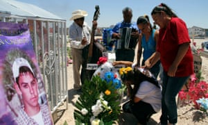 Relatives of Sergio Hernandez mourn at his grave in a cemetery in Ciudad Juarez. The shooting took place in June 2010 on the border between El Paso and Ciudad Júarez.