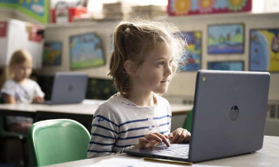 A pupil using a laptop at a primary school in Cardiff, Wales.