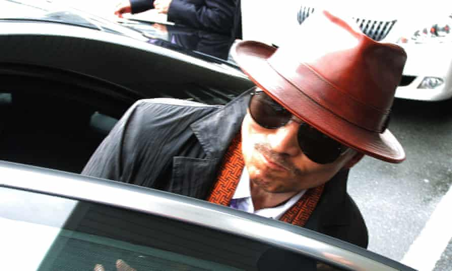 "Shinobu Tsukasa, the boss of Japan's largest ""yakuza"" gang, the Yamaguchi-gumi, gets into a car after arriving at the train station in Kobe, western Japan in 2011. Reports in Japan suggest his mafia group is splitting raising fears of a gang war."