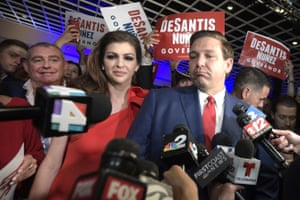 The then Florida governor-elect, Ron DeSantis, right, answers questions from reporters, with his wife Casey, after being declared the winner of the Florida gubernatorial race in November 2018.
