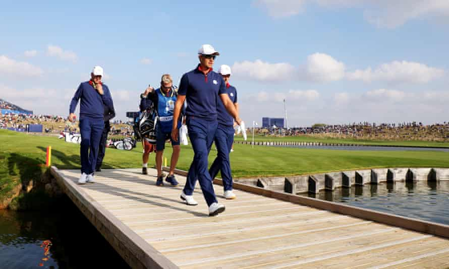 Henrik Stenson and Justin Rose cross a bridge during their 3&2 win over Dustin Johnson and Rickie Fowler.