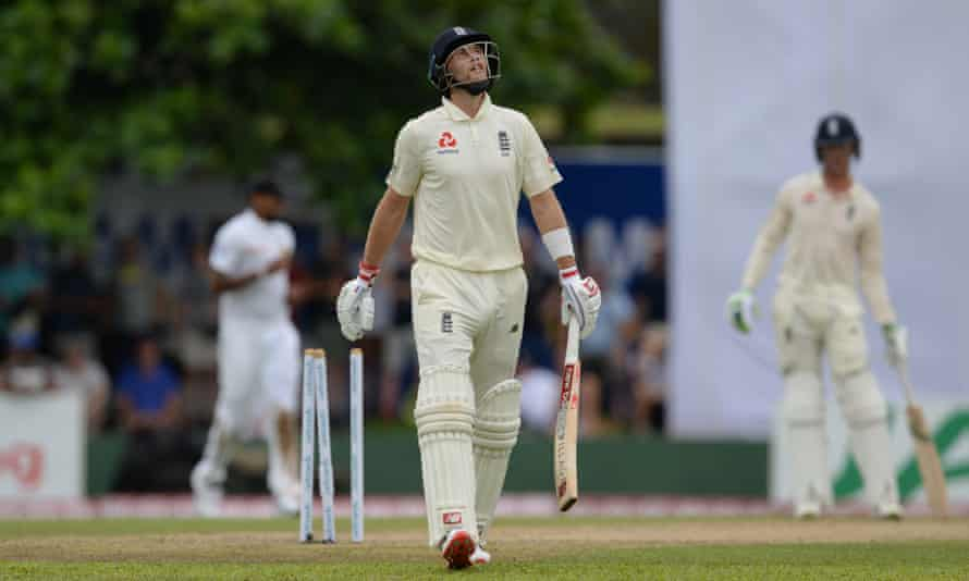 Joe Root of England leaves the field after being dismissed for 35 by Rangana Herath.