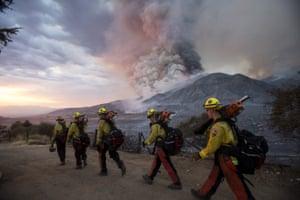 Firefighters walk in line