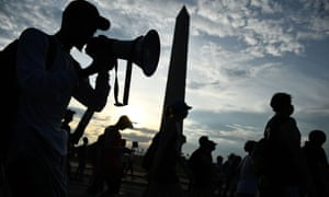 Demonstrators march past the Washington Monument in protest at the death of George Floyd while in police custody.