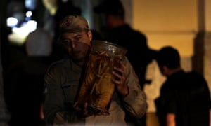 A firefighter rescues items during a fire at the National Museum of Brazil in Rio de Janeiro
