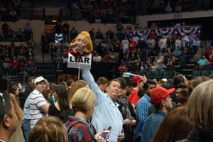 A Trump supporter with a HIllary Clinton puppet