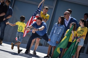 3 May: Bolsonaro with supporters during a protest in favour of the government and against the lockdown in front of the Planalto Palace in Brasília.