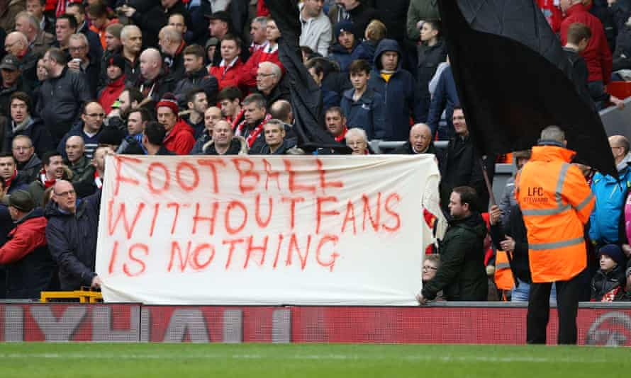 Liverpool fans hold up banners protesting at the proposed season ticket prices.
