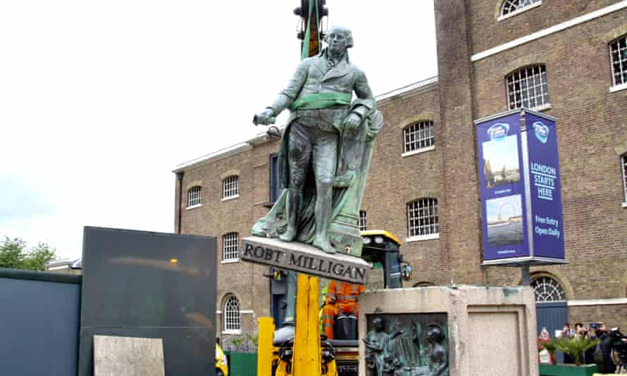 Municipal workers remove the statue of slave-owner and slave merchant Robert Milligan after a petition in West India Quay district of London