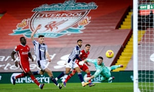 Liverpool's Roberto Firmino (second right) sees his shot saved by West Bromwich Albion goalkeeper Sam Johnstone.