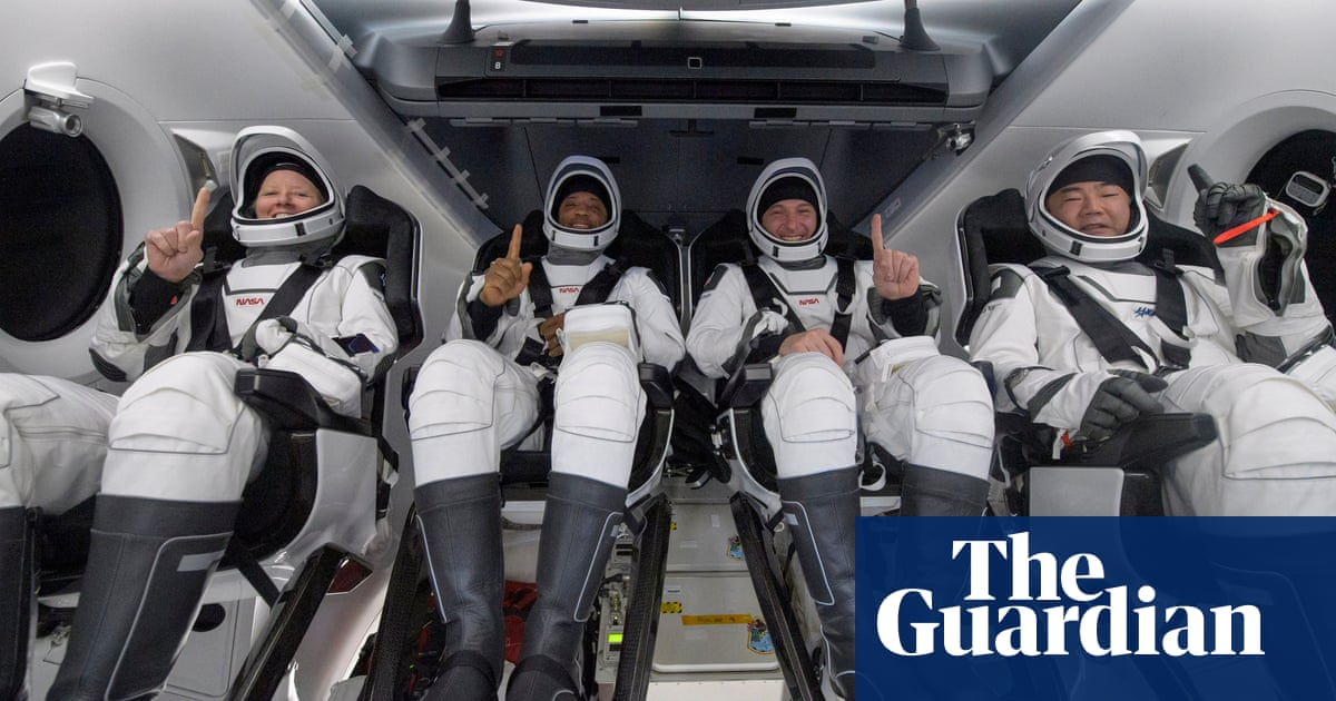 SpaceX returns four astronauts to Earth in darkness
