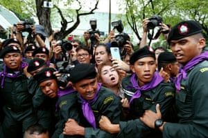 Photographers and journalists are blocked by police during a protest in Bangkok, Thailand