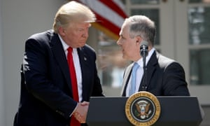 Donald Trump with EPA chief Scott Pruitt last week. A former employee said: 'Staff were paranoid that their programs were going to get cut if they mentioned climate change,'
