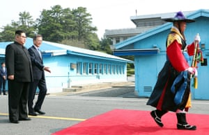 Moon beckons Kim forward to the official summit Peace House building for their meeting