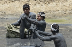 Catfish are rescued from a drying-up lake before being cleaned up and released in to Ahmedabad's Sabarmati river