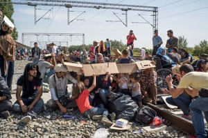 Migrants wait for trains at Tovarnik on the Croatian-Serbian border