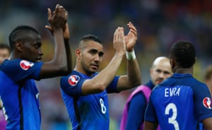 The French players applaud the supporters after the match.