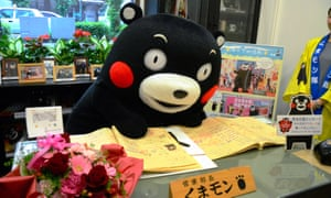 Kumamon reads his correspondence in his office in Kumamon Square in Kumamoto