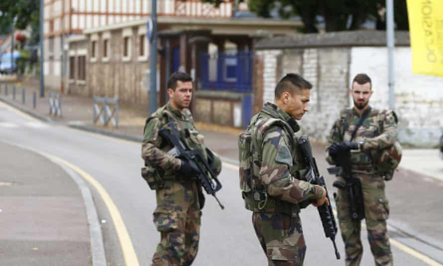 French soldiers prevent access to the scene of the attack in Saint-Étienne-du-Rouvray.