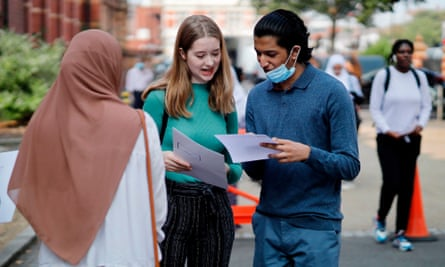 Students at Newham Collegiate Sixth Form react after receiving their A-level results in east London on 13 August, 2020