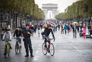 Pedestrians take to the street on the Champs-Élysées, free of its usual traffic