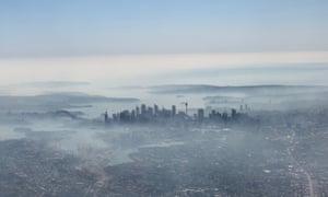 an image taken on a smart phone from a plane window, shows smoke haze blanketing Sydney, Tuesday, November 19, 2019.