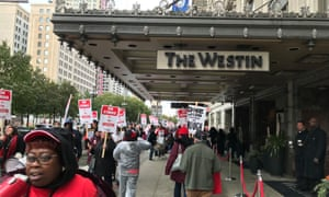 Striking members of Unite Here picket outside the Westin Book Cadillac hotel in Detroit.
