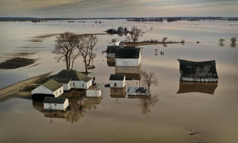 Floodwater surrounds a farm near Craig, Missouri