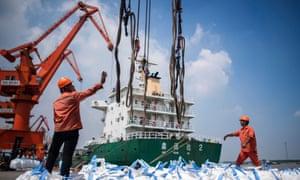Workers unload freight at Zhangjiagang in China's eastern Jiangsu province