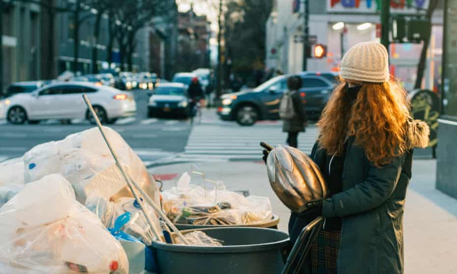 Anna Sacks goes through trash cans and bags on a freezing evening in December 2020.